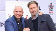 John Travolta says 'good friend' Pitbull was the one who talked him into going bald