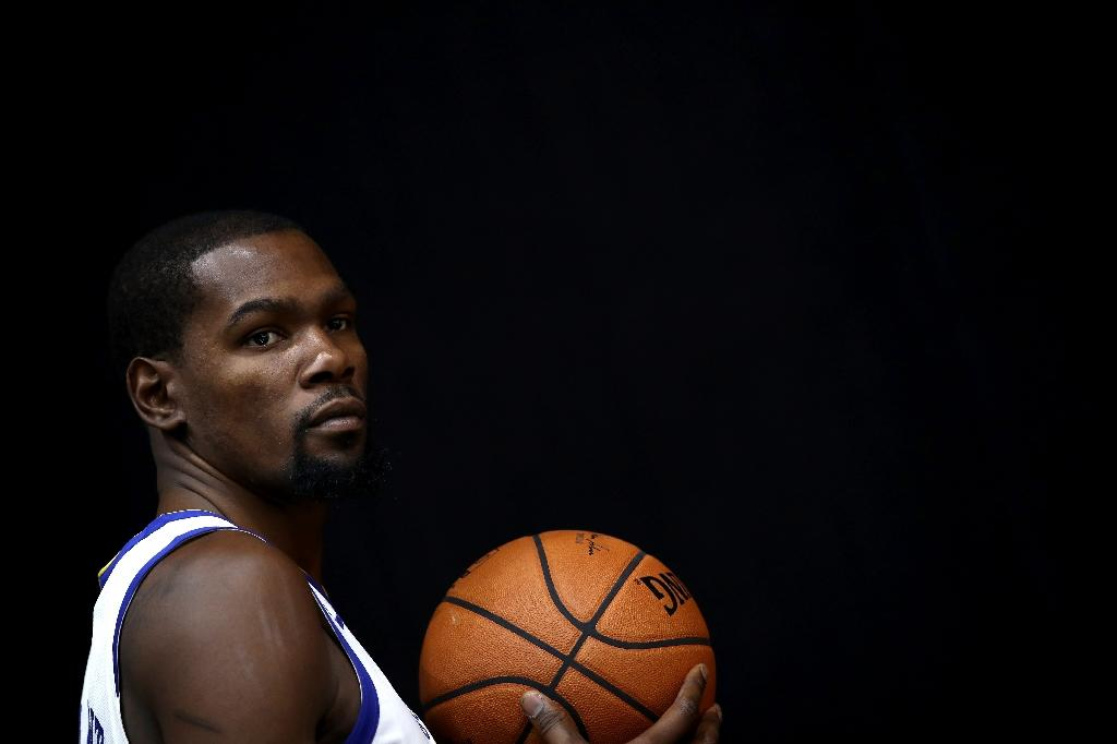 Durant 'at home' with Warriors, but undecided on future