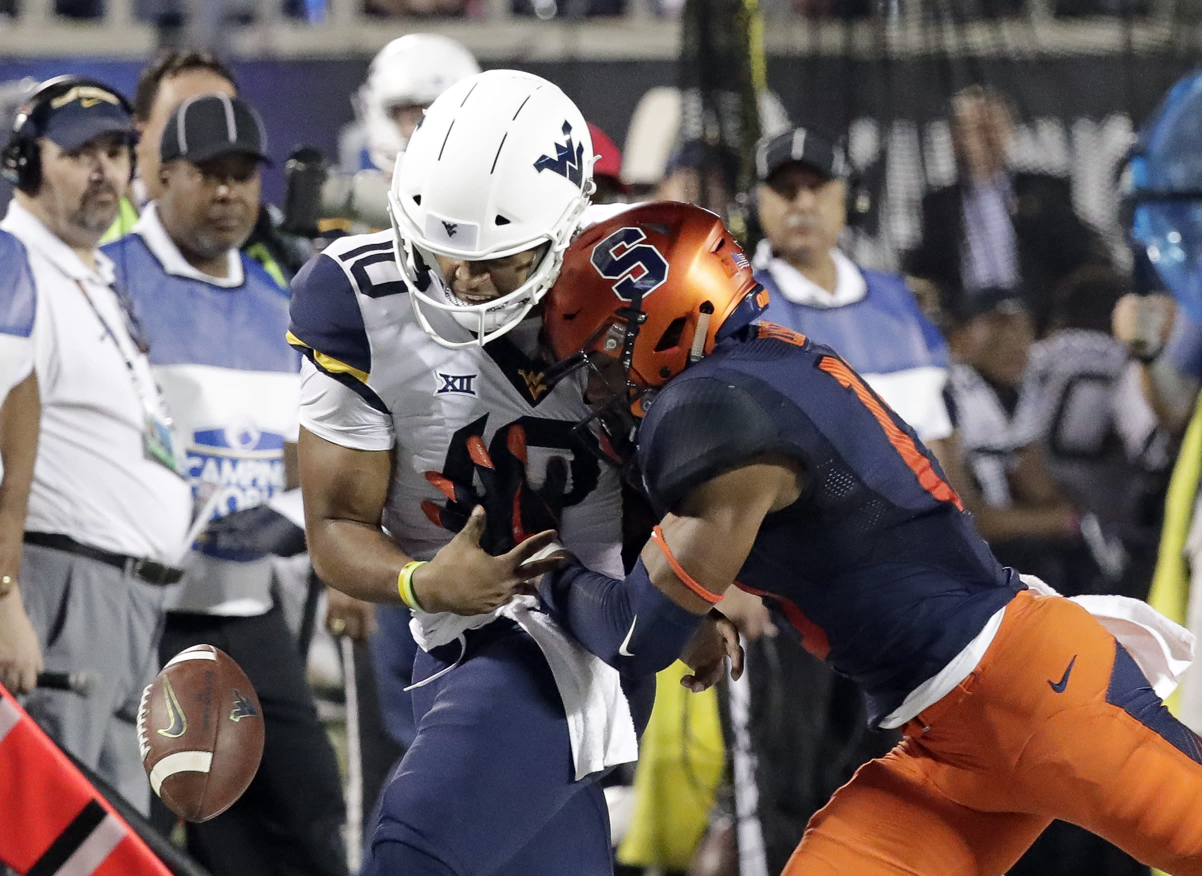 FILE - In this Dec. 28, 2018, file photo, Syracuse defensive back Andre Cisco, right, breaks up a pass intended for West Virginia quarterback Trey Lowe III (10) during the first half of the Camping World Bowl NCAA college football game in Orlando, Fla. Heres a switch for Syracuse coach Dino Babers _ defense rules. Known for his uptempo offenses, the fourth-year coach is looking to his defense to help lift the No. 22 Orange to even greater heights this fall. (AP Photo/John Raoux, File)