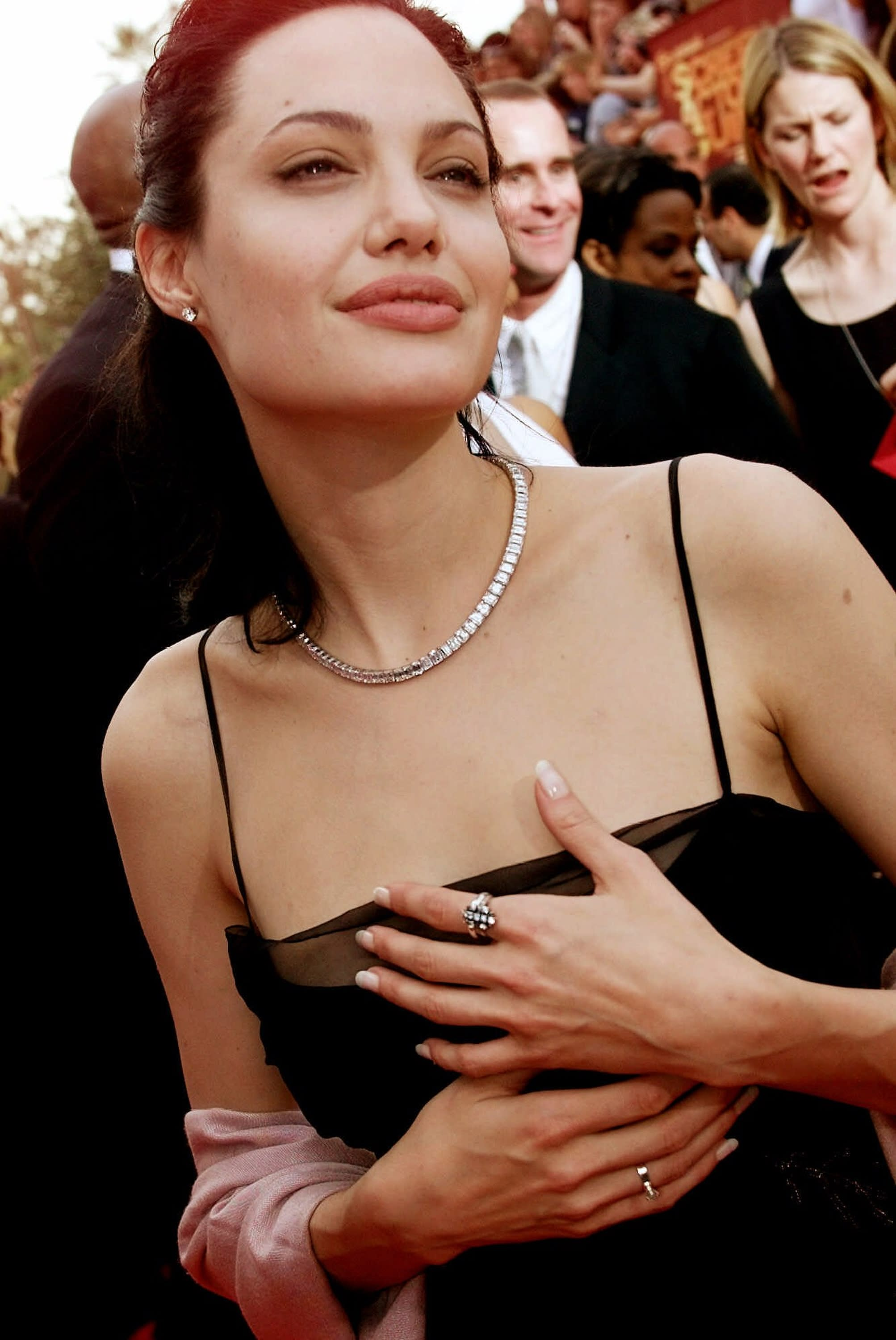 "FILE - In this March 12, 2000 file photo, Actress Angelina Jolie arrives at the 6h Annual Screen Actors Guild Awards in Los Angeles. Jolie won an award for Outstanding Performance for a Female Actor in a Supporting Role for ""Girl, Interrupted."" Less than two weeks after Angelina Jolie had a double mastectomy to avoid breast cancer, her aunt has died from the disease. Jolie's aunt Debbie Martin died at age 61 Sunday in a San Diego-area hospital, her husband Ron Martin tells The Associated Press. Debbie Martin was the younger sister of Jolie's mother Marcheline Bertrand, whose own death from cancer in 2007 inspired the surgery that Jolie described in a May 14 New York Times op-ed. (AP Photo/Damian Dovarganes, File)"