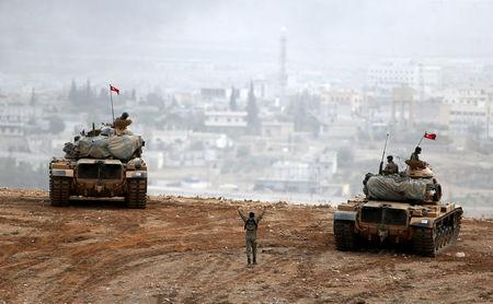 Turkish army tanks take position on top of a hill near Mursitpinar border crossing in the southeastern Turkish town of Suruc in Sanliurfa province, Turkey, October 11, 2014. REUTERS/Umit Bektas/File photo