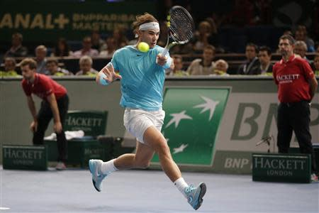 Nadal of Spain hits a return to compatriot Ferrer in their semi-final match at the Paris Masters men's singles tennis tournament at the Palais Omnisports of Bercy in Paris