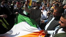 UK apologizes after protesters tear down Indian flag in London