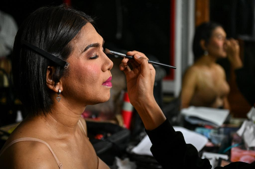 The media leans heavily on caricatures of the transgender community as catty, bawdy figures (AFP Photo/Chalinee Thirasupa)