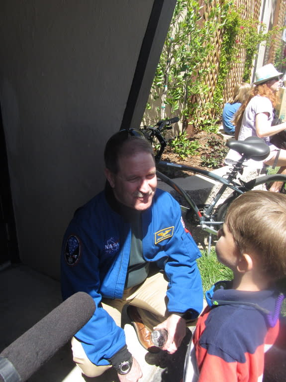 NASA science chief John Grunsfeld talks to an aspiring young space scientist after talking at Maker Faire Bay Area on May 18, 2013.