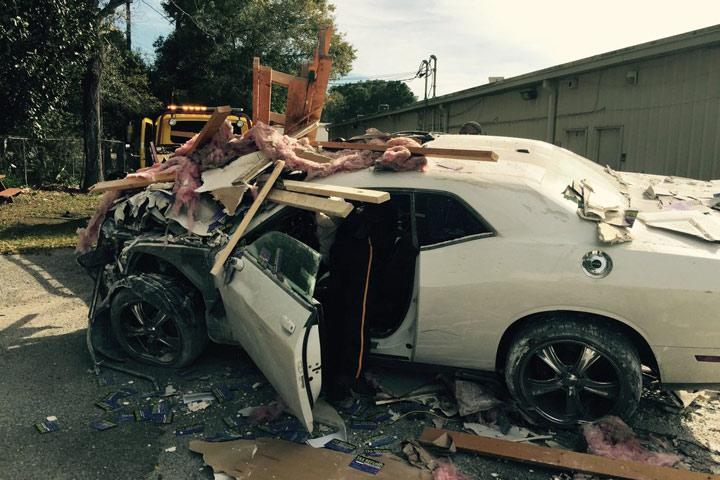 Man Crashes A Dodge Challenger Through A Building Attempting To Time
