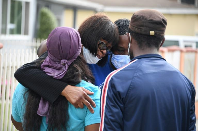 Fletcher Fair, (2L), the aunt of Dijon Kizzee who was fatally shot by Los Angeles County sheriff's deputies, is comforted after speaking at a press conference September 1, 2020 in Los Angeles, California at the location where Kizzee was shot to death .