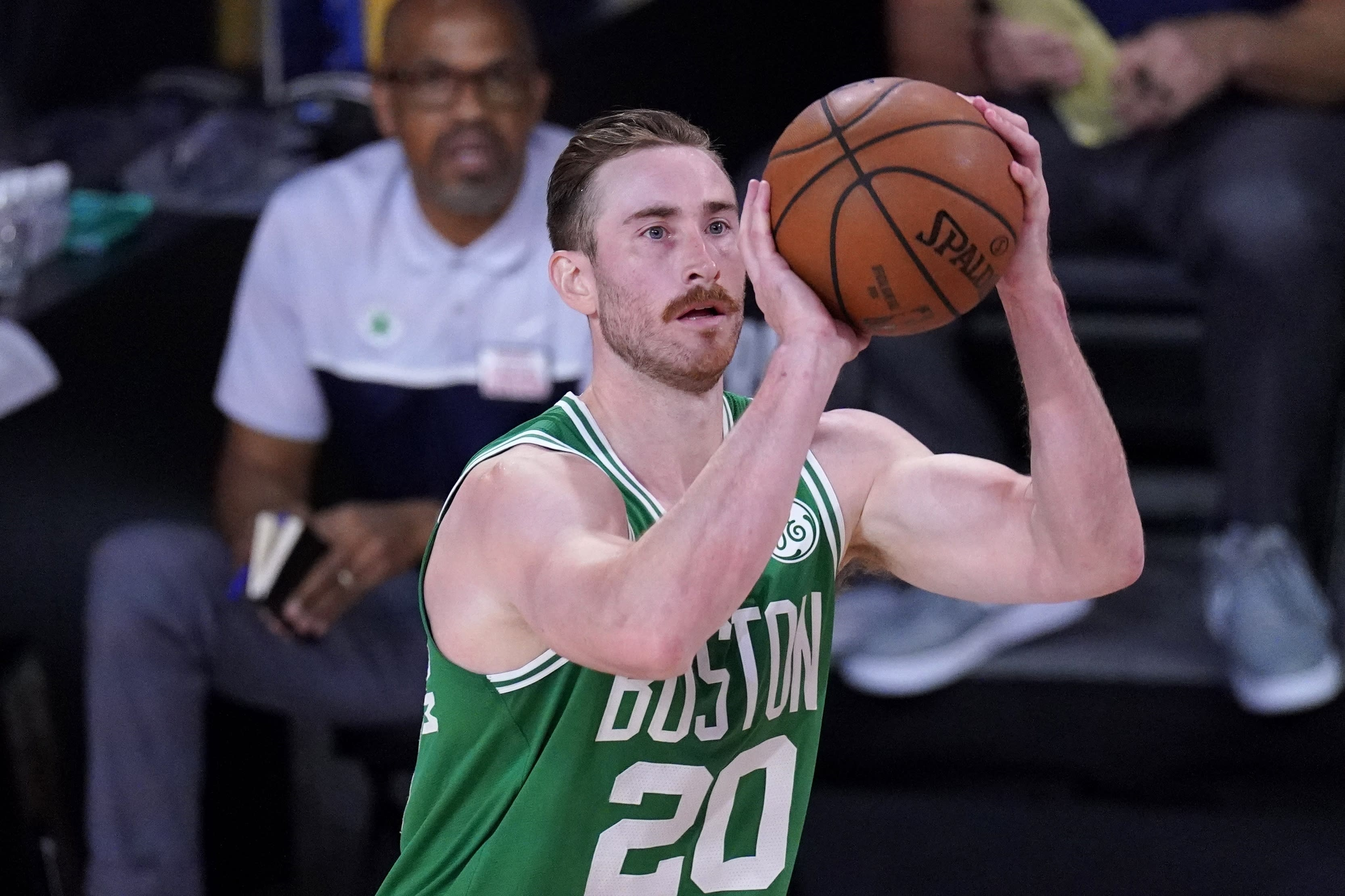 Boston Celtics' Gordon Hayward (20) attempts a shot during the second half of an NBA conference final playoff basketball game against the Miami Heat on Saturday, Sept. 19, 2020, in Lake Buena Vista, Fla. (AP Photo/Mark J. Terrill)