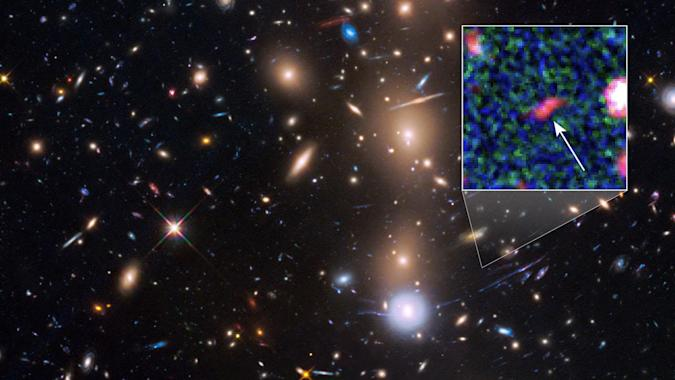 Hubble spots faint galaxy with 'natural magnifying glass'