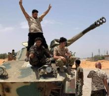 Libya rivals sign ceasefire deal in Geneva