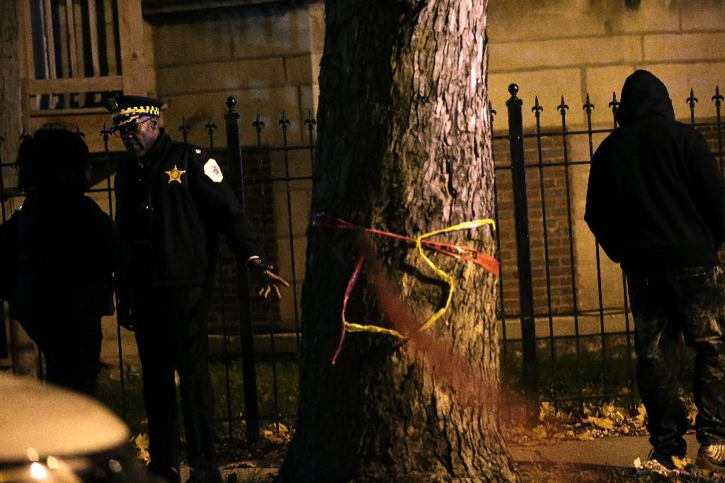 Chicago police chief Eddie Johnson spent much of 2016 hammering home a key idea: Gangs, guns and an outmatched police force were a toxic brew (AFP Photo/Joshua Lott)