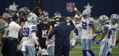 Cowboys head coach Mike McCarthy, center with hand raised, celebrates an onside kick recovery in the fourth quarter against the Falcons. (AP Photo/Ron Jenkins)
