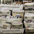 Members from both sides urge Postal Service to undo changes slowing mail