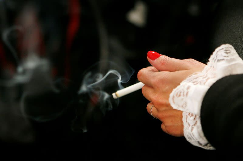 FILE PHOTO: A model smokes backstage before the start of a fall fashion show during New York Fashion Week