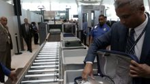 U.S. to unveil enhanced airline security plan to avoid laptop ban