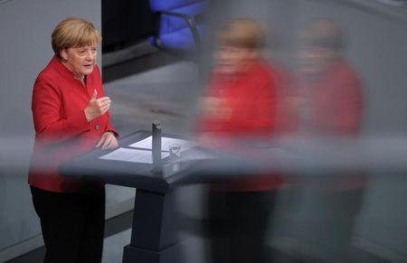 German Chancellor Angela Merkel speaks during a meeting at the lower house of parliament Bundestag on 2017 budget in Berlin