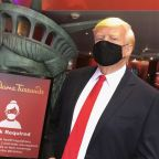 Trump's Madame Tussauds wax figure reminds visitors they must wear masks, even though the real president rarely wears them