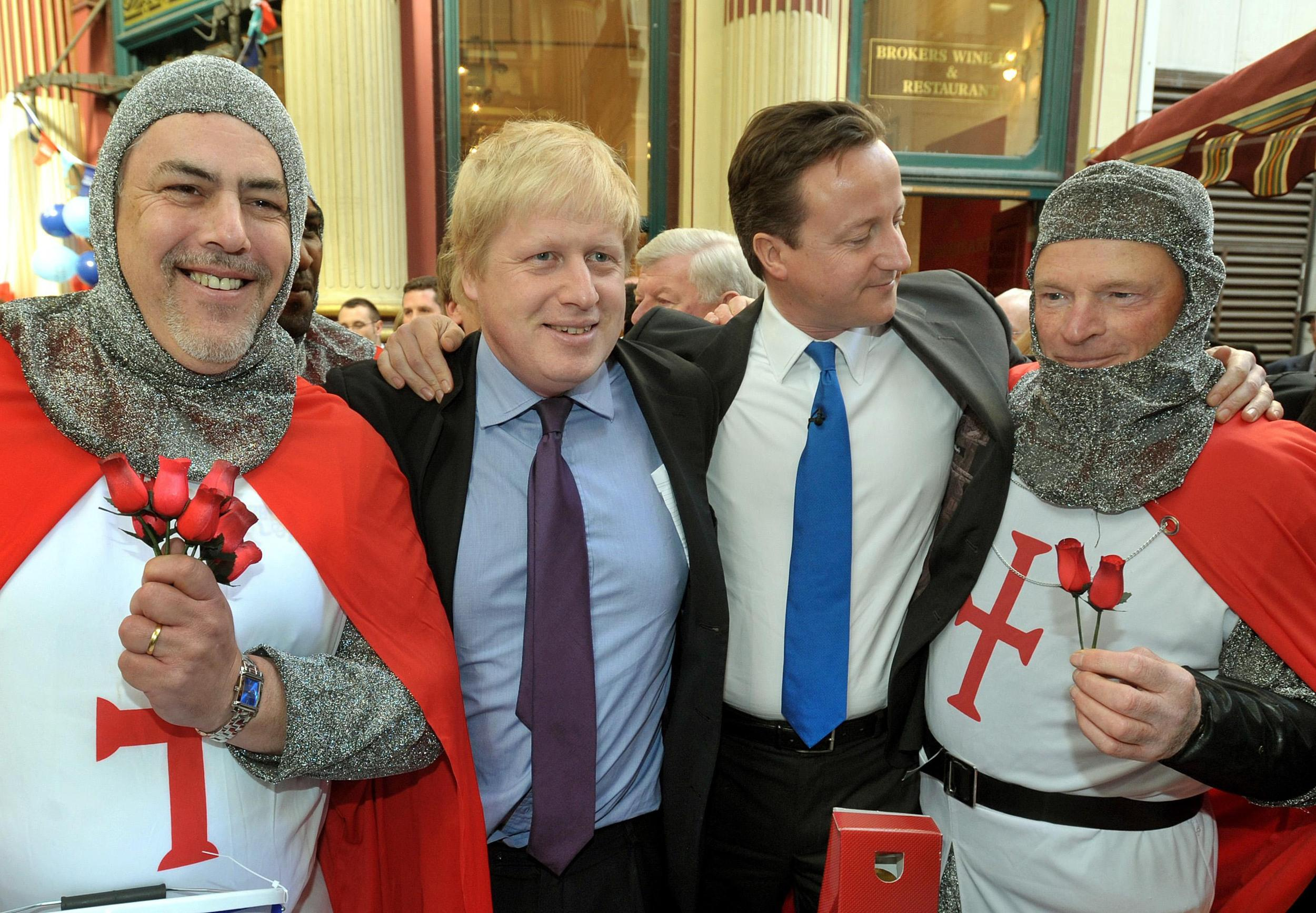 Leader of the Conservative Party David Cameron (2nd right) with Mayor of London Boris Johnson (2nd left) as they celebrate St George's day in Leadenhall Market in the City of London.