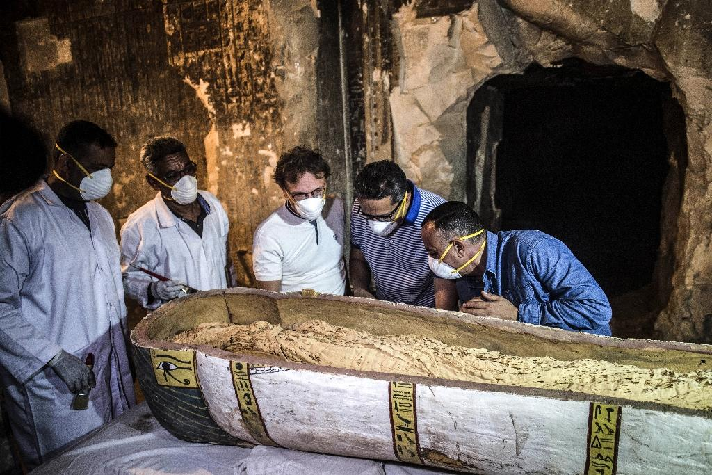 Egyptian Antiquities Minister Khaled al-Enany inspects a sarcophagus at the Al-Assasif necropolis in the southern city of Luxor on November 24, 2018 (AFP Photo/Khaled DESOUKI)