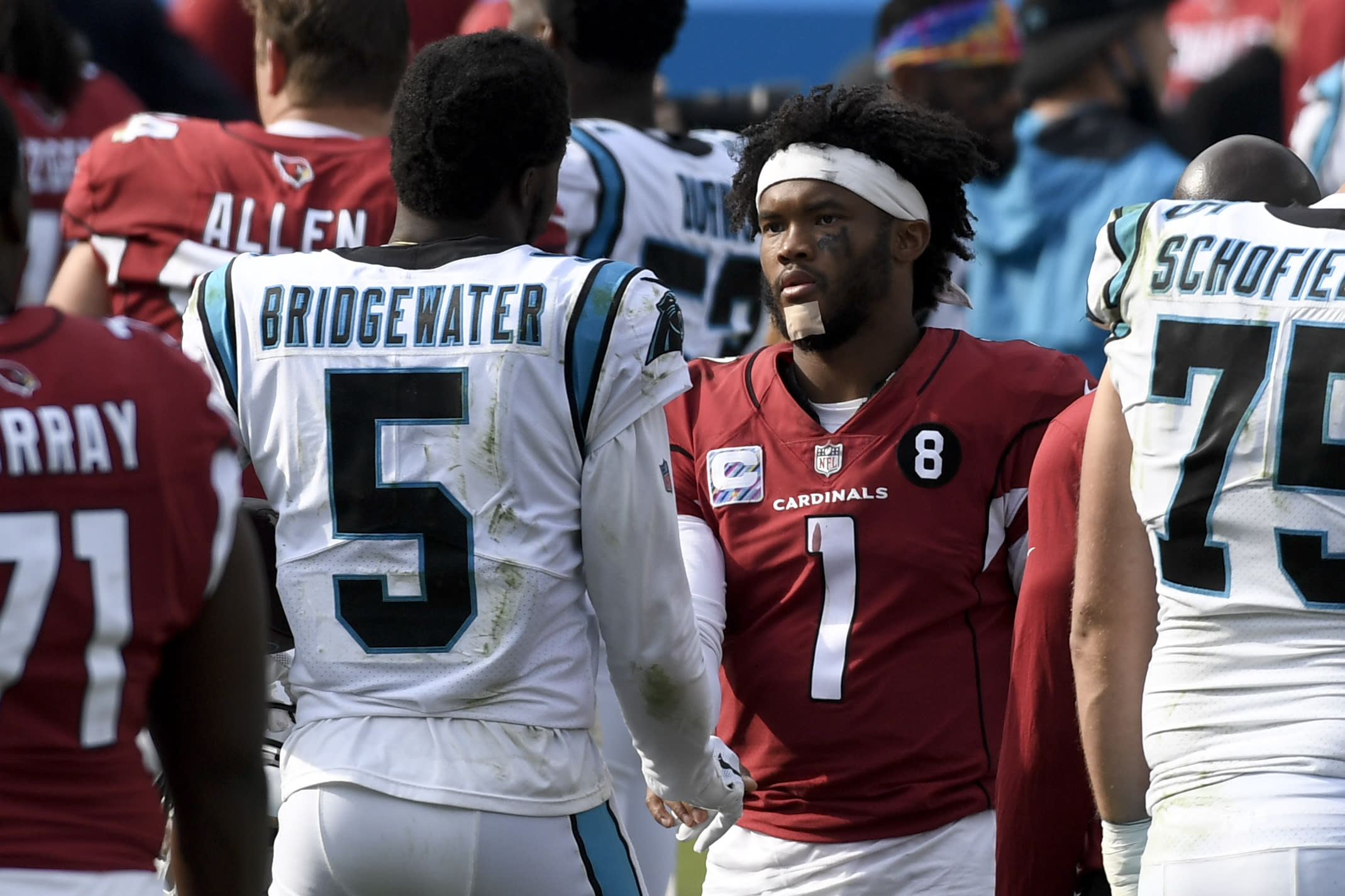 Carolina Panthers quarterback Teddy Bridgewater, left, and Arizona Cardinals quarterback Kyler Murray meet on the field after an NFL football game Sunday, Oct. 4, 2020, in Charlotte, N.C. (AP Photo/Mike McCarn)