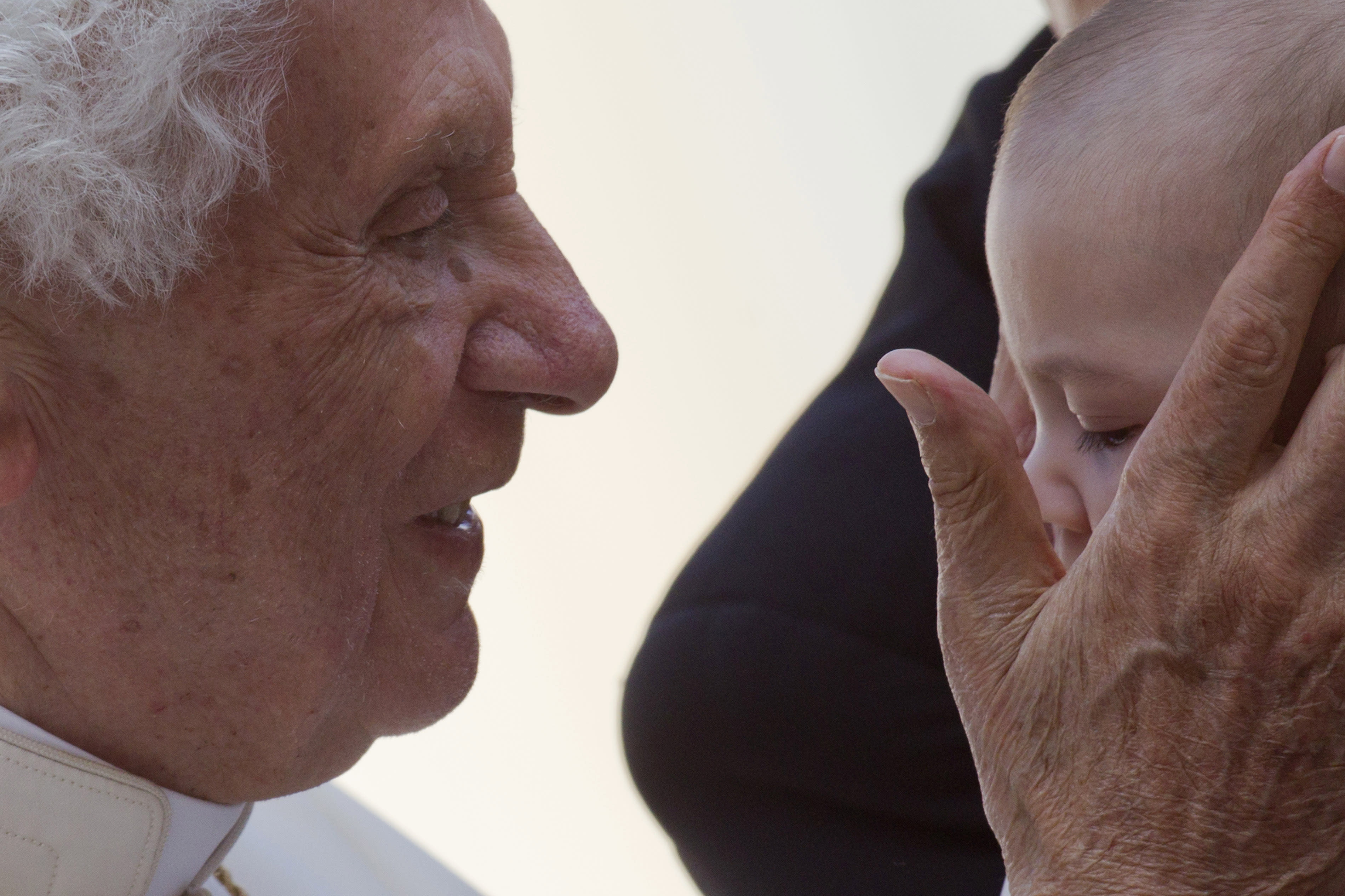 Pope Benedict XVI blesses blesses a baby at the end of his weekly general audience, in St. Peter's Square at the Vatican, Wednesday, Oct. 24, 2012. Benedict has named six new cardinals, adding prelates from Lebanon, the Philippines, Nigeria, Colombia, India and the United States to the ranks of cardinals who will elect his successor. He made the surprise announcement during the audience and said they would be elevated at a consistory Nov. 24. (AP Photo/Andrew Medichini)