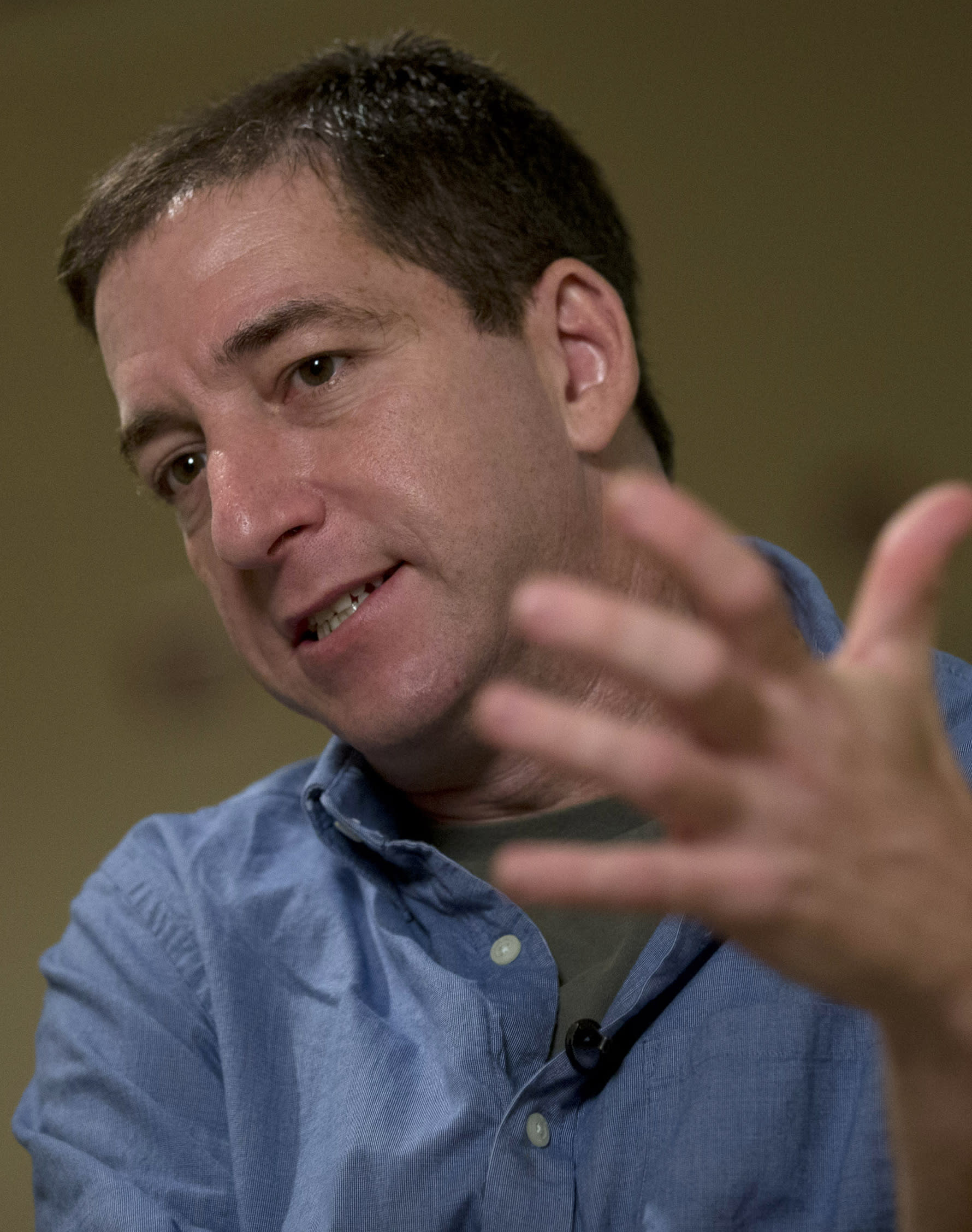 """Journalist Glenn Greenwald speaks during an interview with the Associated Press in Rio de Janeiro, Brazil, Sunday, July 14, 2013. Greenwald, The Guardian journalist who first reported Edward Snowden's disclosures of U.S. surveillance programs, says the former National Security Agency analyst has """"very specific blueprints of how the NSA do what they do.""""(AP Photo/Silvia Izquierdo)"""