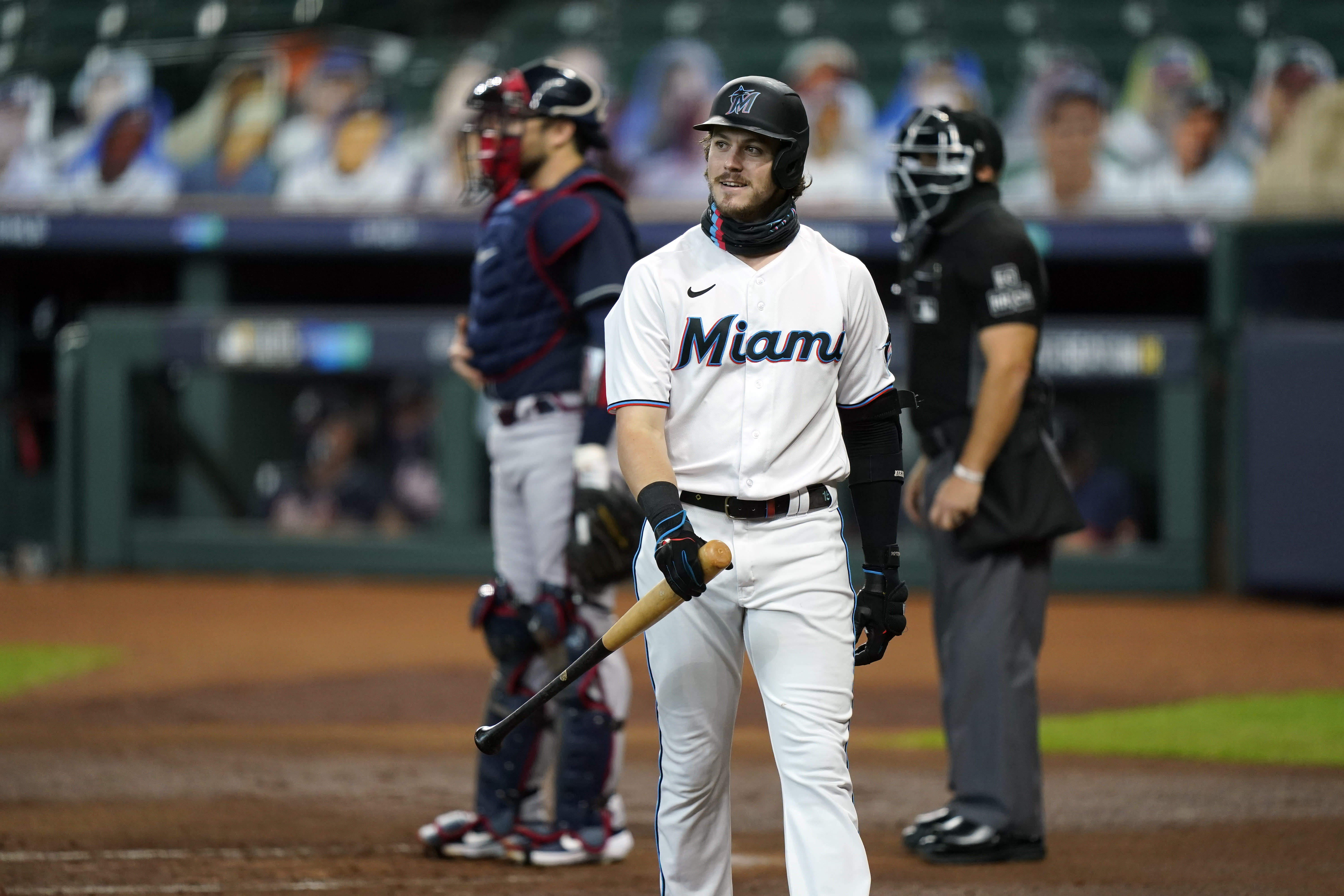 Miami Marlins' Brian Anderson (15) reacts after striking out in the first inning in Game 3 of a baseball National League Division Series against the Atlanta Braves, Thursday, Oct. 8, 2020, in Houston. (AP Photo/David J. Phillip)