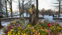 "Old Navy ""Flower Empowers"" NYC's Historical Female Statues In Celebration Of International Women's Day"