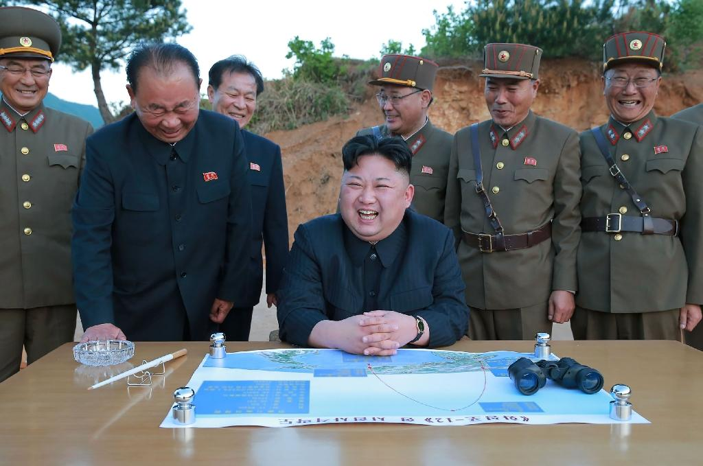 North Korea's Kim Jong-Un (centre) boasted that he could now strike any part of the United States with missiles