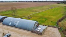 You could live in this old WW2 airfield hangar which is now a 5-bed dream home
