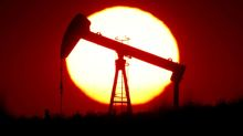 Oil mixed as storm threatens U.S. gulf production