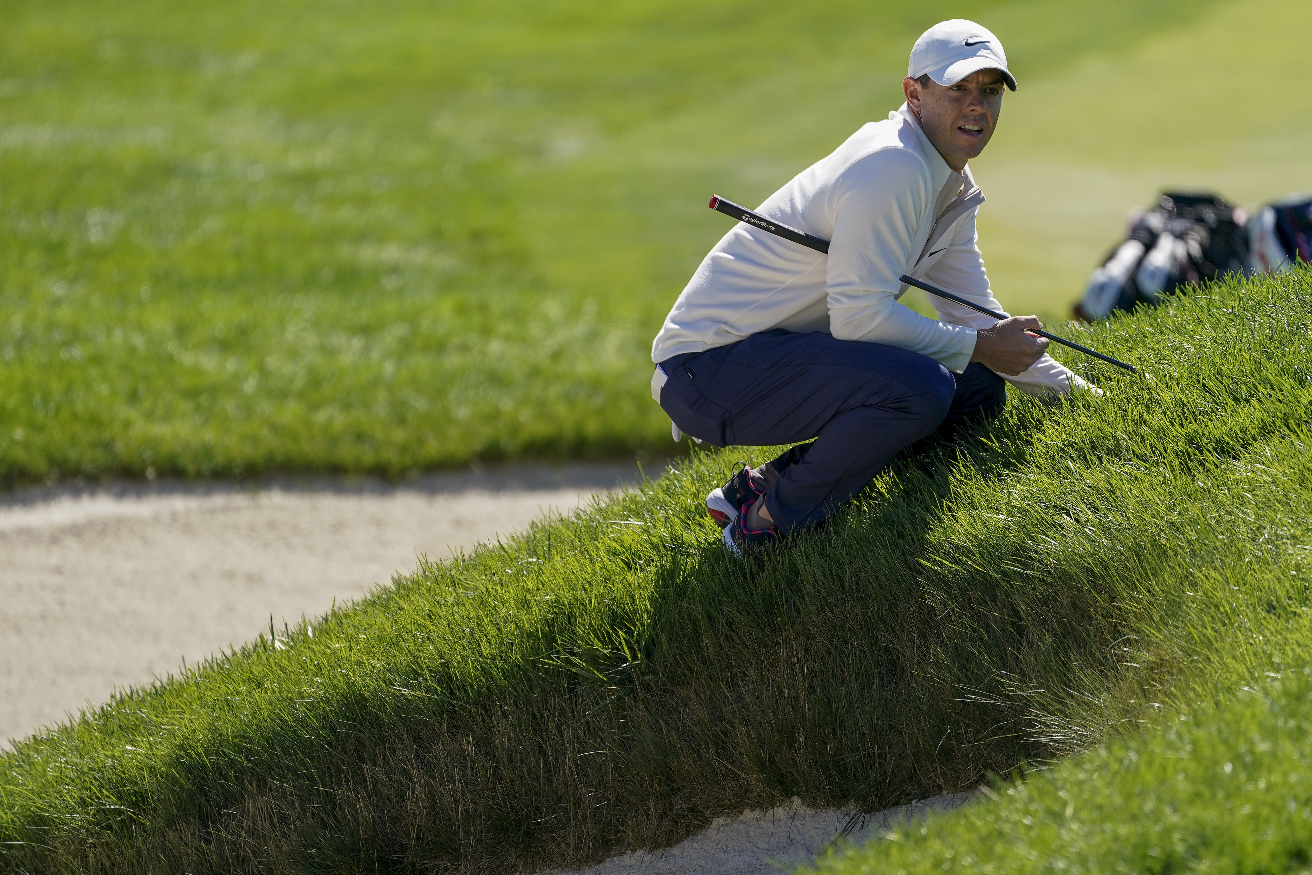 Rory McIlroy, of Northern Ireland, lines up a putt on the first green during the third round of the US Open Golf Championship, Saturday, Sept. 19, 2020, in Mamaroneck, N.Y. (AP Photo/John Minchillo)