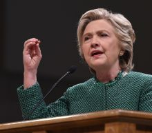 Riding high in polls, Clinton barnstorms swing states