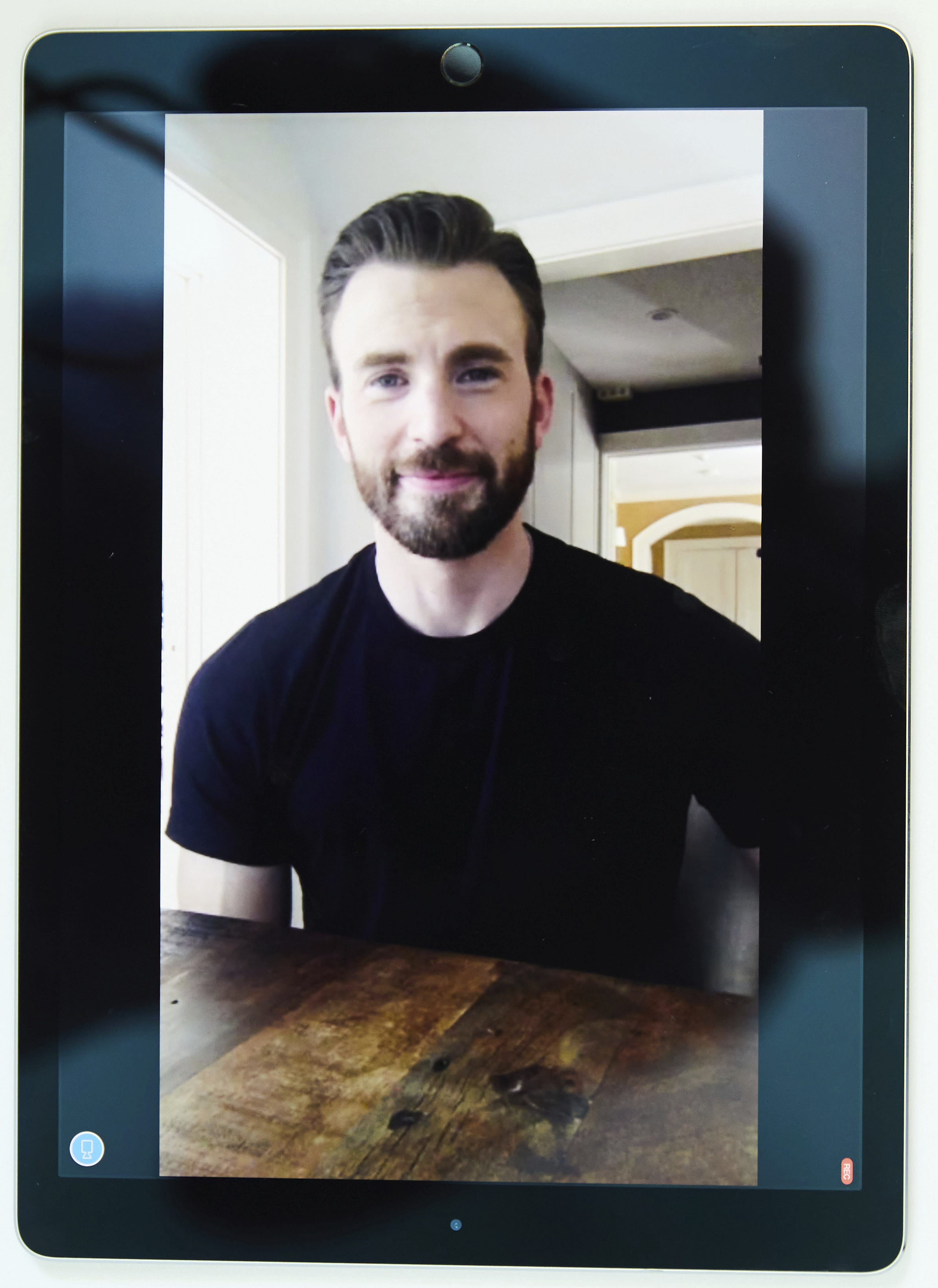 """In this July 30, 2020 photo, Chris Evans, co-founder of the civic engagement video-based app """"A Starting Point"""" with Mark Kassen, is photographed on a tablet during a remote portrait session with photographer in Los Angeles and subject in Boston, Mass. (Photo by Matt Sayles/Invision/AP)"""