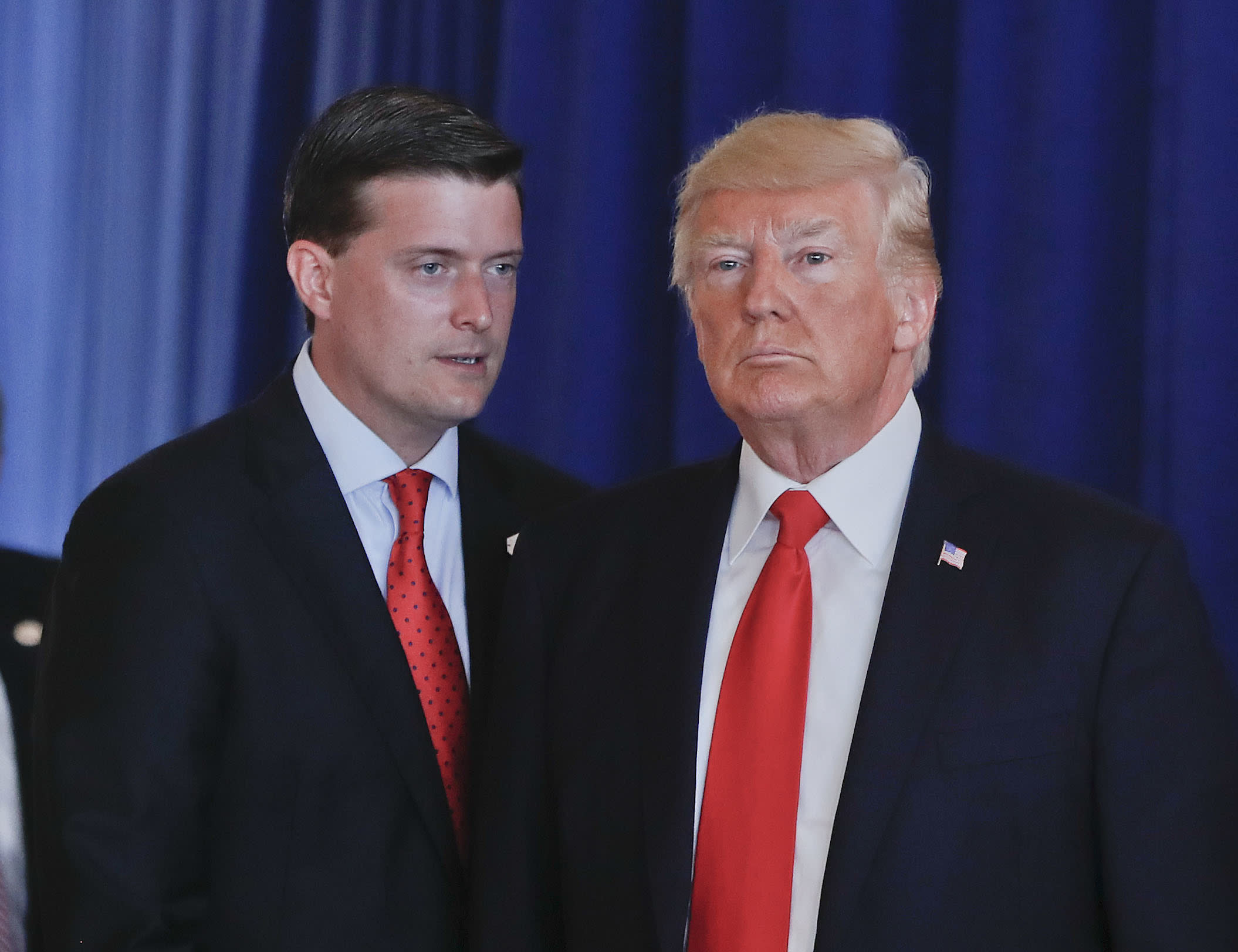 "In this Aug. 12, 2017, photo, Rob Porter, left, White House Staff Secretary, speaks to President Donald Trump after Trump made remarks regarding the ongoing situation in Charlottesville, Va., at Trump National Golf Club in Bedminister, N.J. The White House has instructed Porter and another former aide to President Donald Trump not to appear at a House Judiciary Committee hearing Tuesday, Sept. 17, 2019, saying Porter and Rick Dearborn are ""absolutely immune"" from testifying at what the panel is calling its first impeachment hearing. (AP Photo/Pablo Martinez Monsivais)"