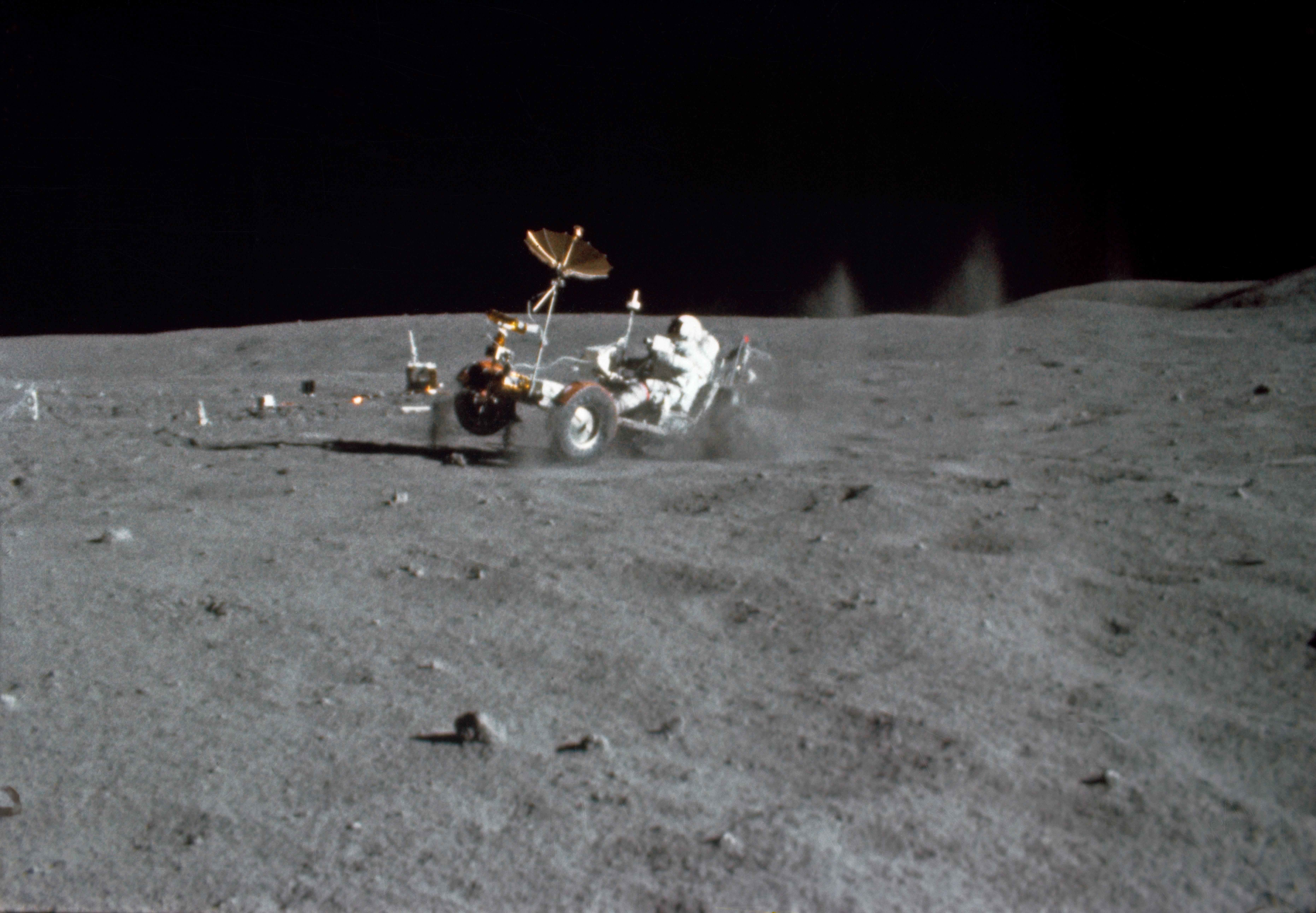 Astronaut John W. Young drives the Lunar Roving Vehicle (LRV) during the first Apollo 16 spacewalk at the Descartes landing site on the moon in this  April 21, 1972 handout still frame from motion picture film obtained by Reuters July 15, 2019.   NASA/Handout via REUTERS          ATTENTION EDITORS - THIS IMAGE WAS PROVIDED BY A THIRD PARTY.