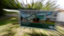 Auctions surge, but clearance rate slips