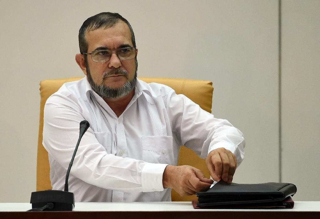 The head of the FARC guerrilla Timoleon Jimenez, aka Timochenko speaks during a meeting with Colombian President Juan Manuel Santos (out of frame) in Havana on September 23, 2015