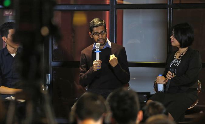 Google CEO Sundar Pichai (C) gestures as he addresses a conference with Vietnamese IT community in Hanoi, Vietnam December 22, 2015. REUTERS/Kham