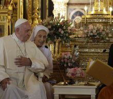 The Latest: Pope commits Church to work with Thai Buddhists