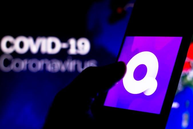 BRAZIL - 2020/04/08: In this photo illustration the Quibi logo seen displayed on a smartphone with a computer model of the COVID-19 coronavirus in the background. (Photo Illustration by Rafael Henrique/SOPA Images/LightRocket via Getty Images)