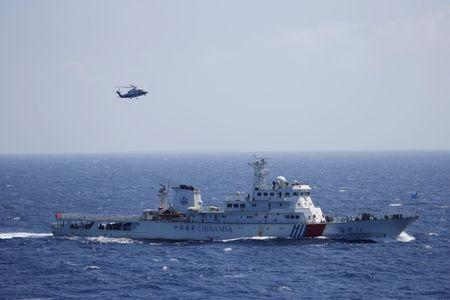 Chinese ship and helicopter are seen during a search and rescue exercise near Qilian Yu subgroup in the Paracel Islands, which is known in China as Xisha Islands, South China Sea, July 14, 2016. REUTERS/Stringer REUTERS