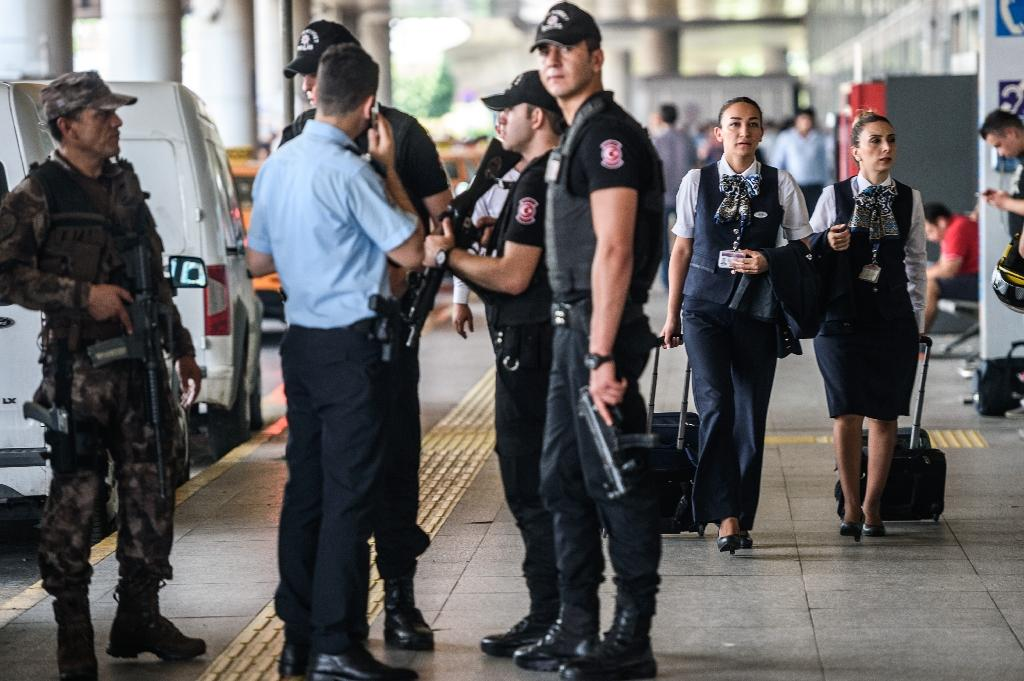 Turkish special force police officers stand guard near the explosion site at Ataturk airport, on July 1, 2016, three days after a suicide attack targeting the airport killed 45 people
