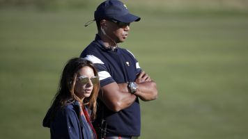 Tiger's girlfriend dropped from wrongful death suit