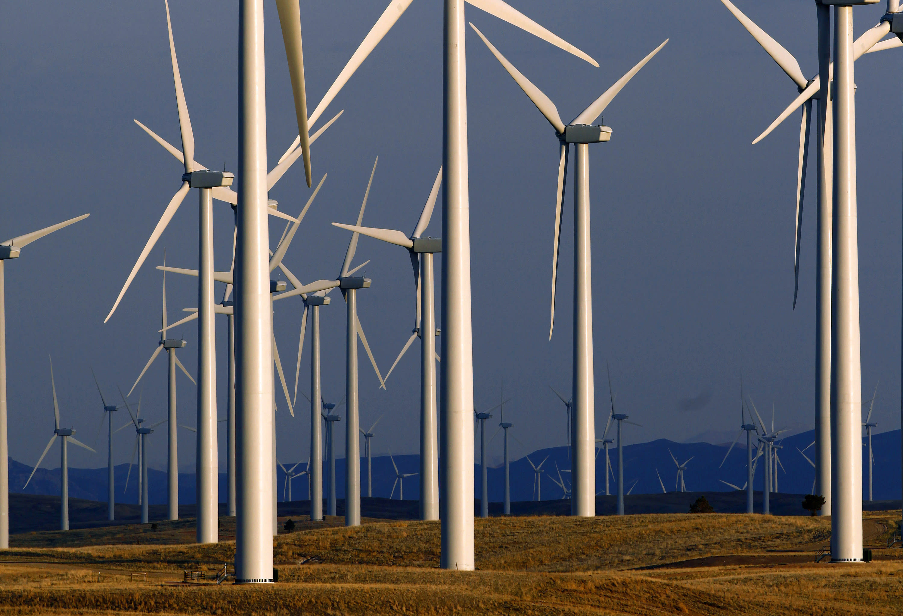FILE - This May 6, 2013 file photo shows a wind turbine farm owned by PacifiCorp near Glenrock, Wyo. Land-based turbines are rising by the thousands across America, from the remote Texas panhandle to cornfields of Iowa. (AP Photo/Matt Young)