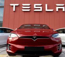 Tesla posts surprise 3Q profit, stock surges