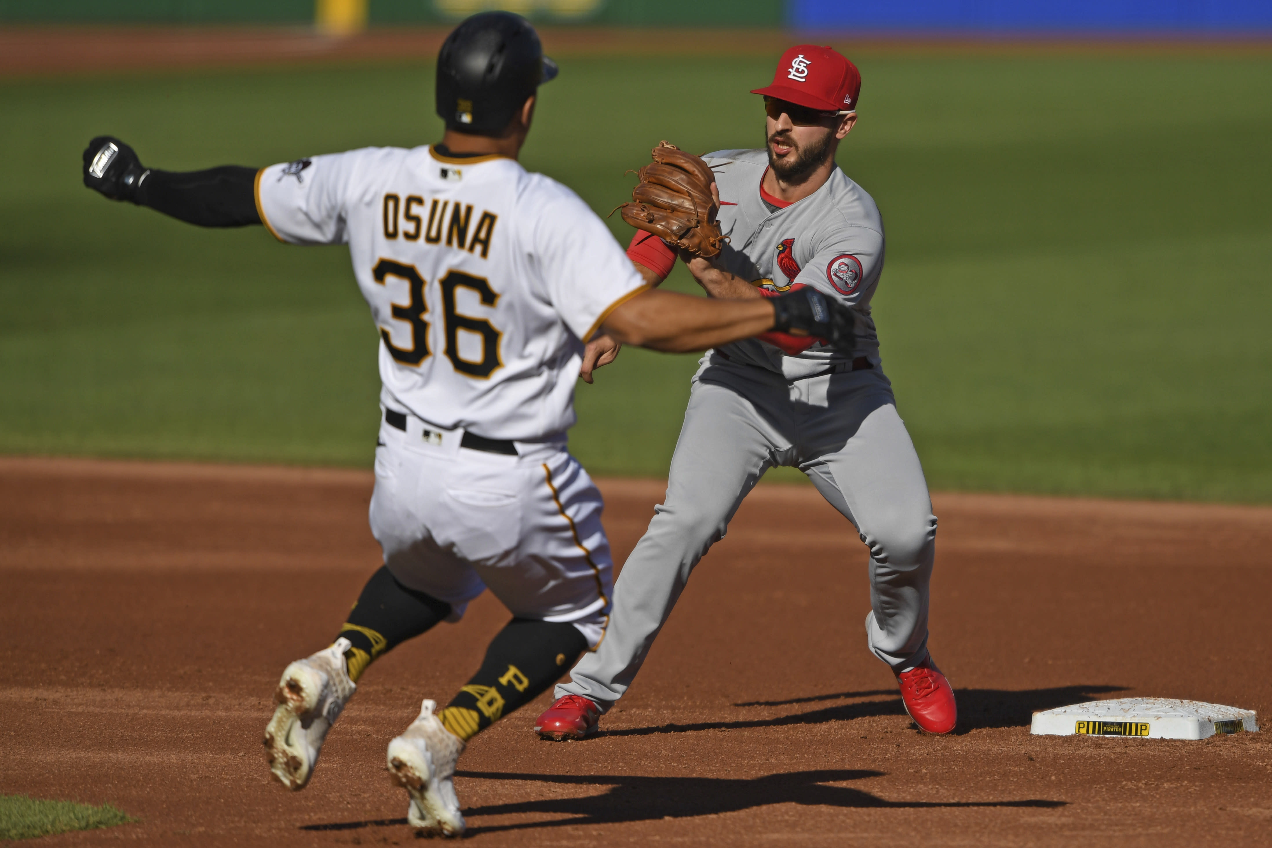 St. Louis Cardinals' Paul DeJong prepares to tag out Pittsburgh Pirates' Jose Osuna during the third inning of a baseball game, Sunday, Sept. 20, 2020, in Pittsburgh. (AP Photo/David Dermer) Pennsylvania
