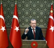 Turkey vows to press Syria offensive despite warning from pro-Assad forces