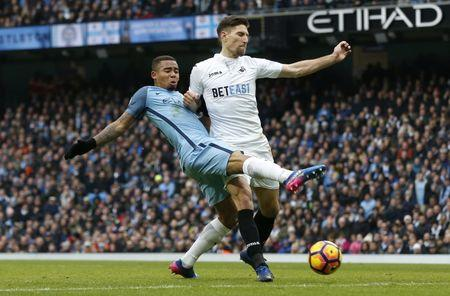 Manchester City's Gabriel Jesus in action with Swansea City's Federico Fernandez