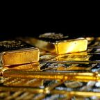 Gold pulls back from record high as dollar rebound weighs